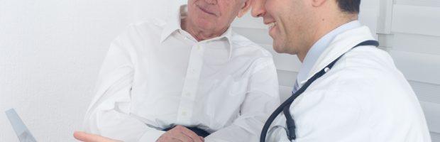 dentist showing elderly patient something